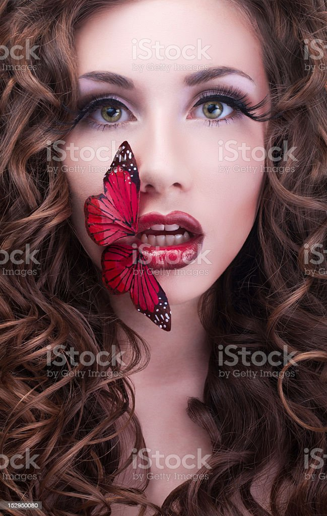 Studio beauty portrait with red butterfly royalty-free stock photo