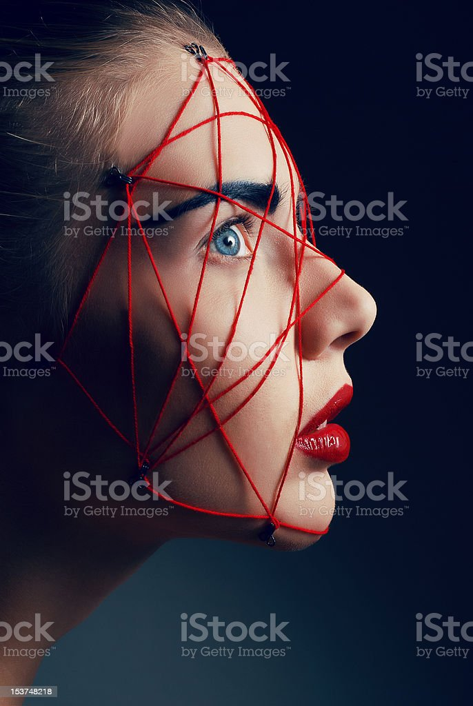 Studio beauty with red knitted net on face royalty-free stock photo
