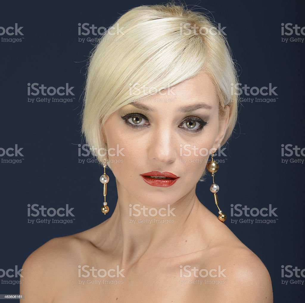 studio close-up of a lovely young blonde girl stock photo