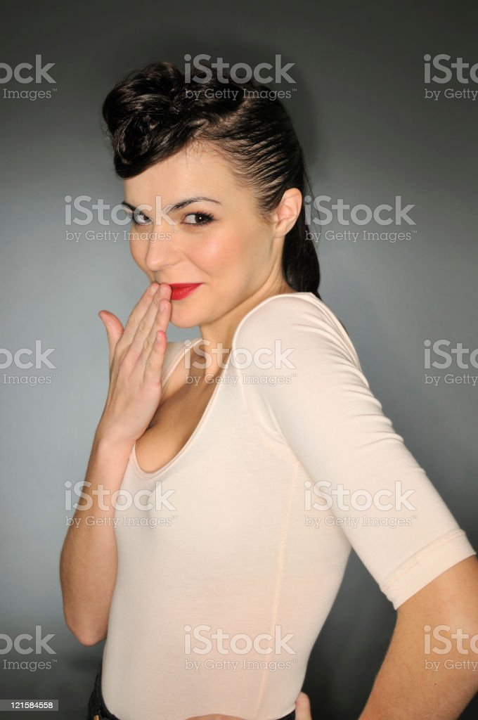 Studio fashion portrait of young woman on dark background royalty-free stock photo