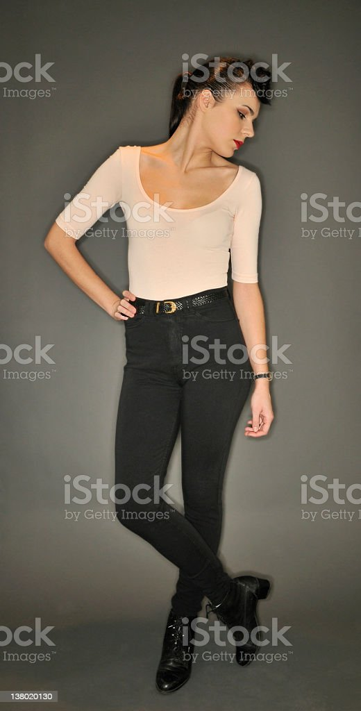 Studio fashion portrait of young woman on gray background royalty-free stock photo