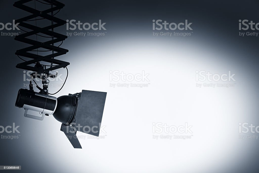 Studio flash on a white wall stock photo