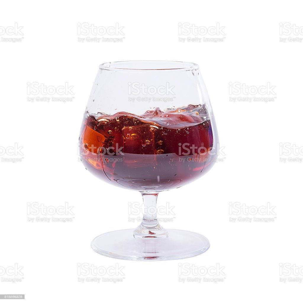 Studio isolated splashing whiskey over white background. Clipping path included. stock photo
