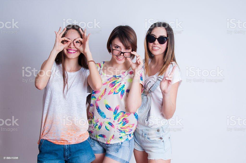 Studio lifestyle portrait of three best friends hipster girls stock photo
