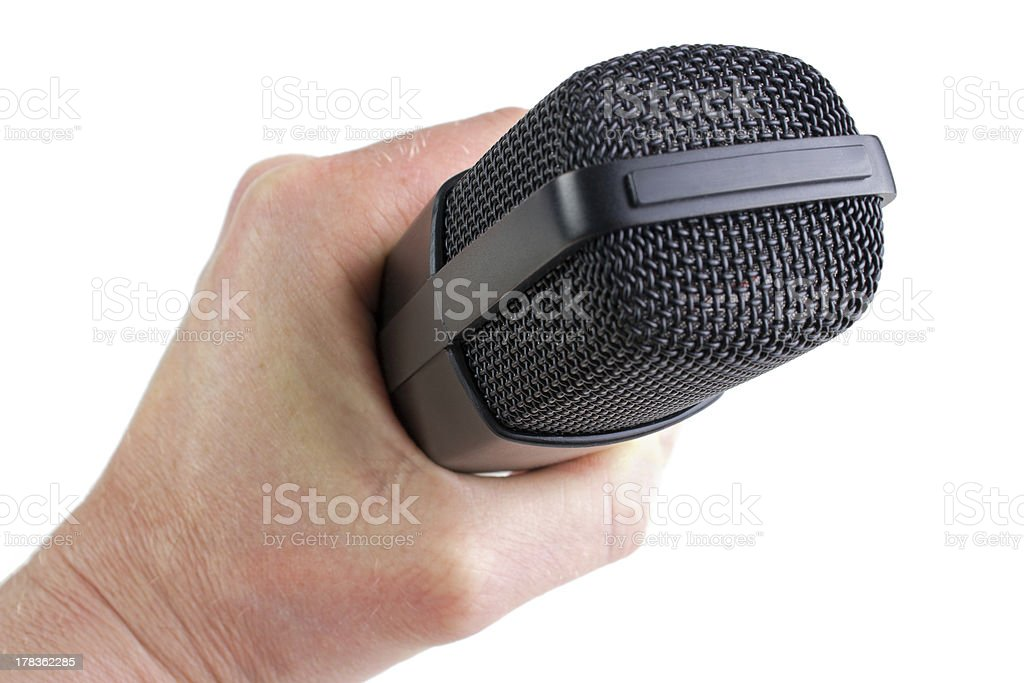 Studio microphone in hand royalty-free stock photo