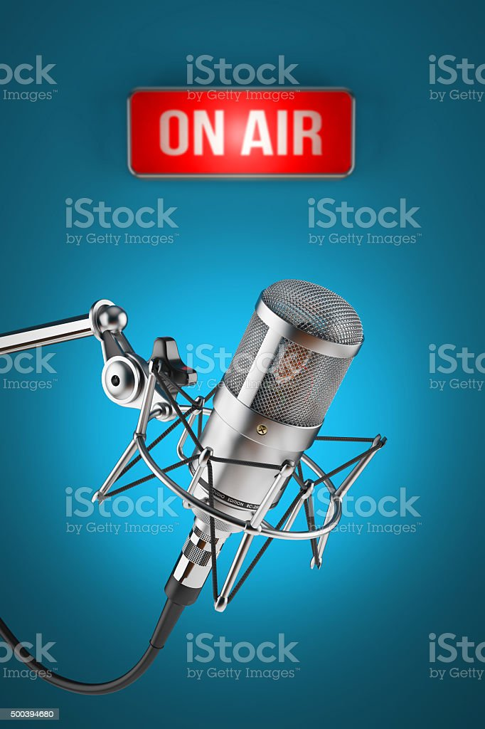 Studio microphone stand on background sign light ON AIR stock photo