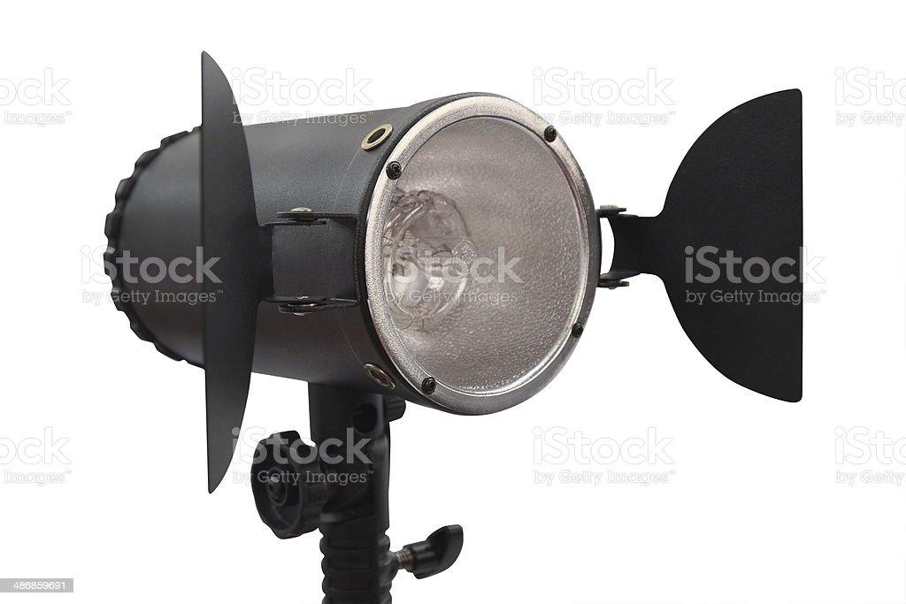 studio monoblock flash light on tripod stock photo