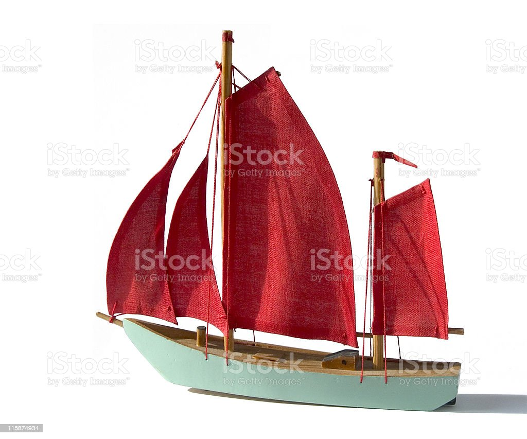 Studio Objects; Turquoise model sailing ship with red sails stock photo