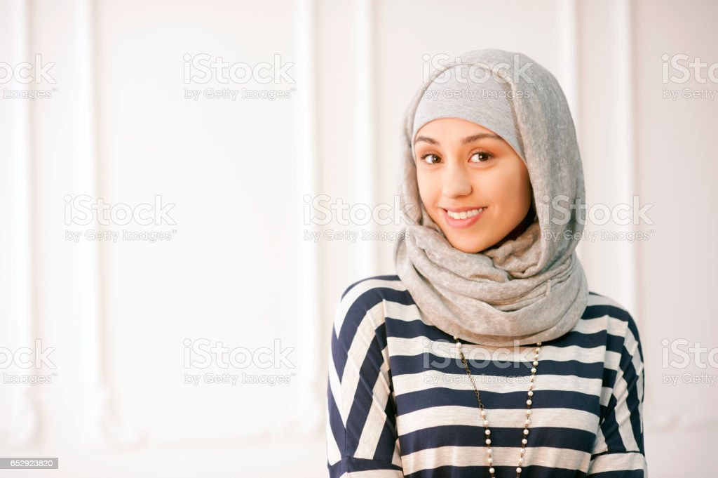 Studio photo of a beautiful young woman dressed oriental type in the Muslim style stock photo