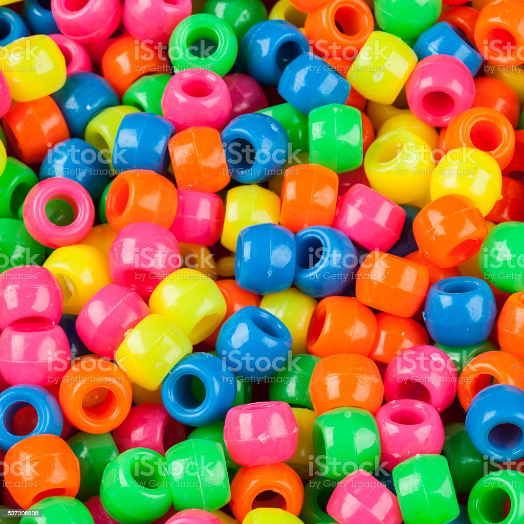 Studio photo of multi-colored beads in bright colors stock photo