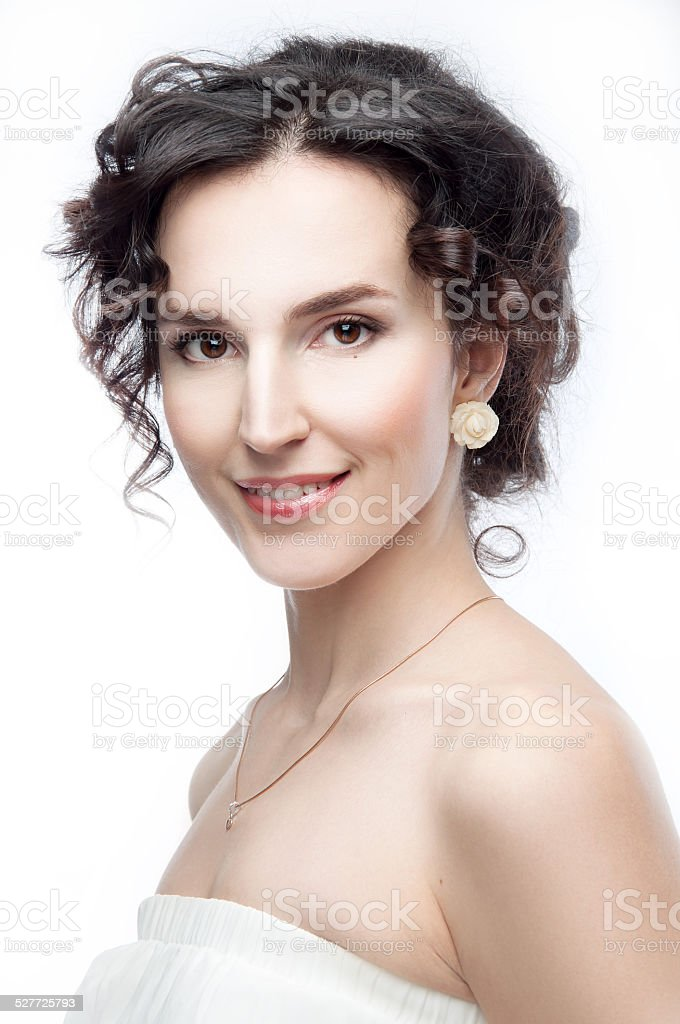 Studio portrait of a beautiful brunette with evening hairdo stock photo