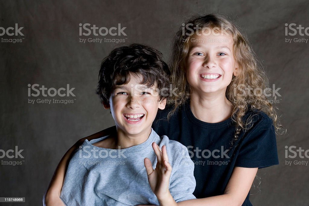 Studio portrait of a happy brother and sister. royalty-free stock photo
