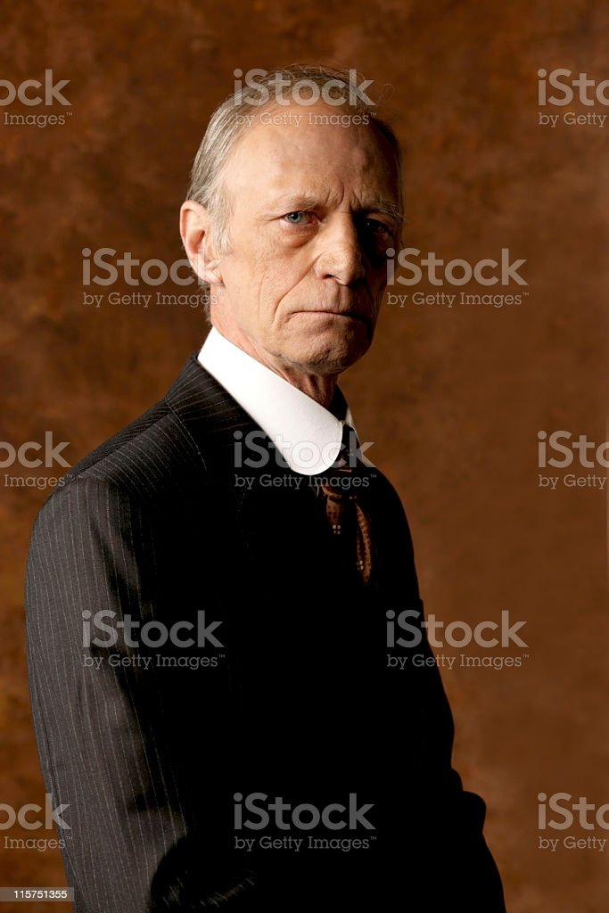 Studio portrait of an old man in a suit royalty-free stock photo