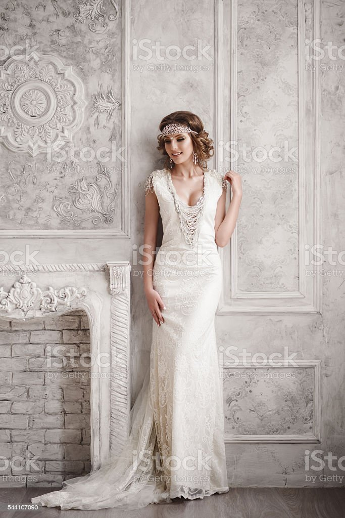 Studio portrait of beautiful bride with perfect hairstyle and ma stock photo
