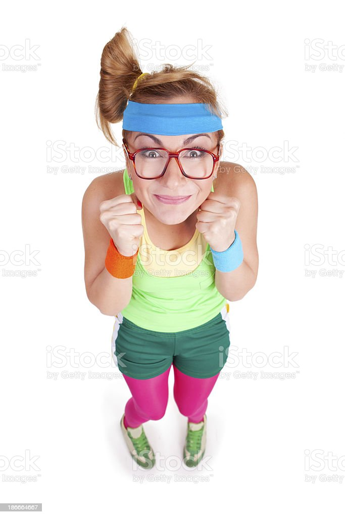 Studio portrait of excited nerdy fitness girl with glasses royalty-free stock photo