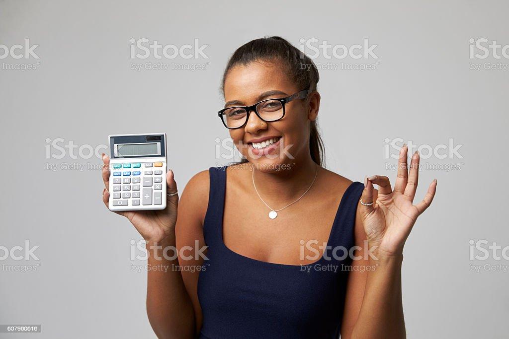 Studio Portrait Of Female Accountant Using Calculator stock photo