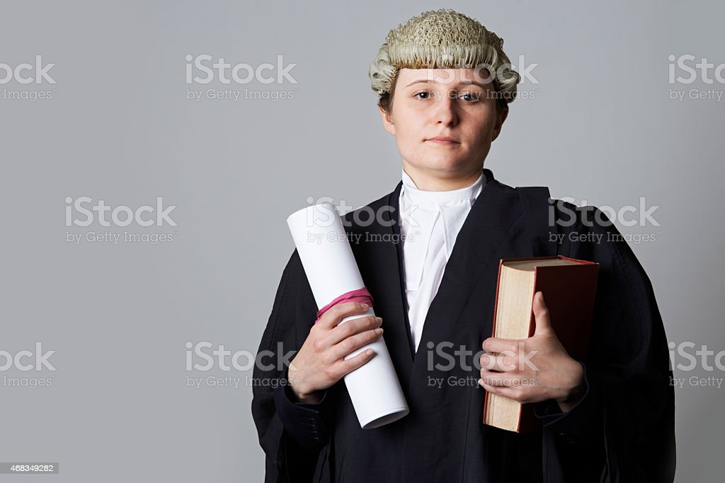 Studio Portrait Of Female Lawyer Holding Brief And Book stock photo