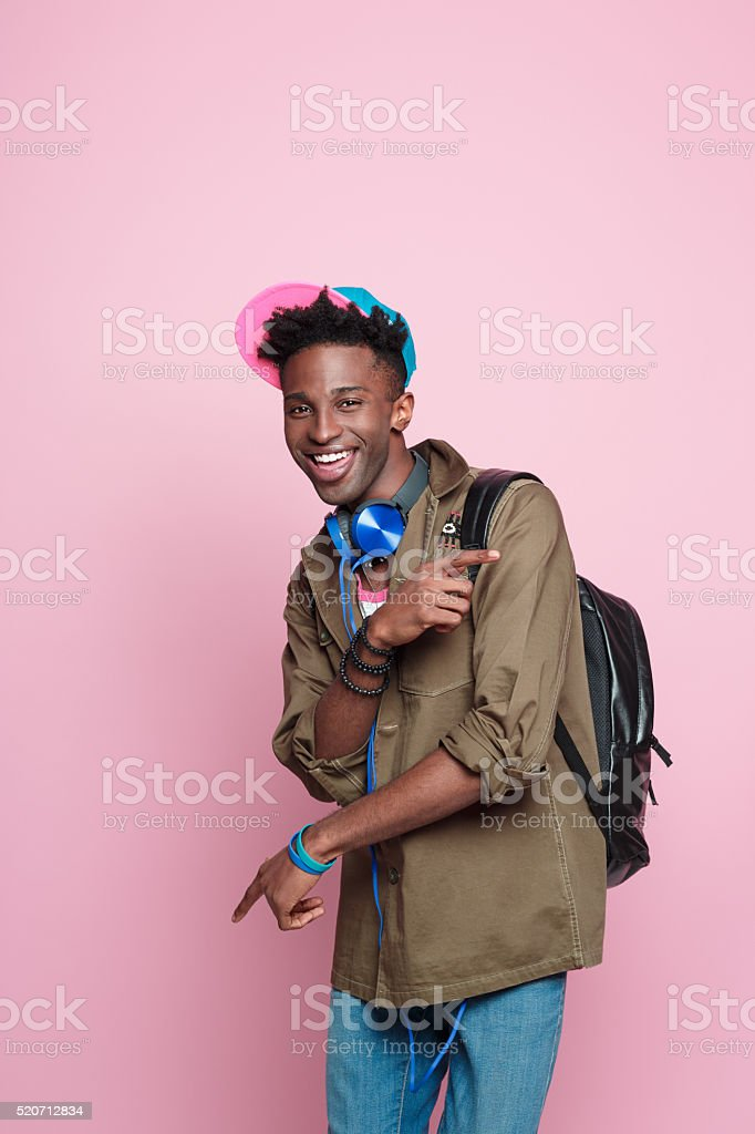 Studio portrait of funky, excited afro american student stock photo
