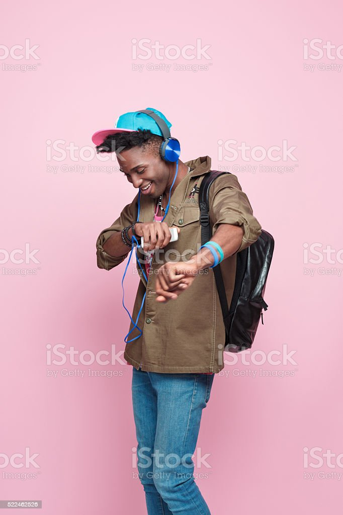Studio portrait of funky, excited afro american young man stock photo