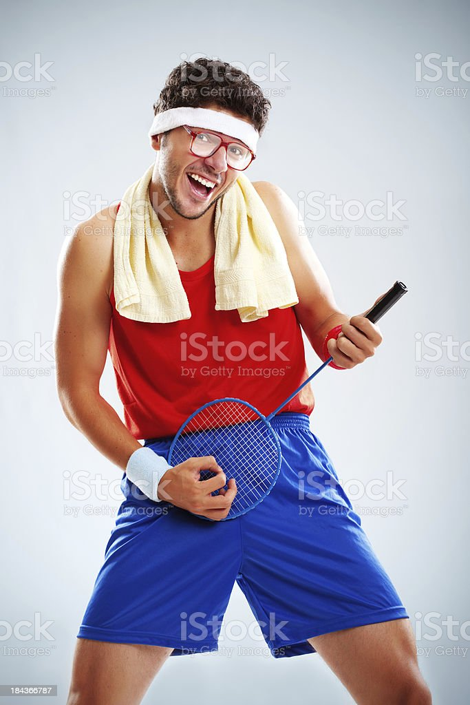 Studio portrait of funny tennis player acting like rock star royalty-free stock photo