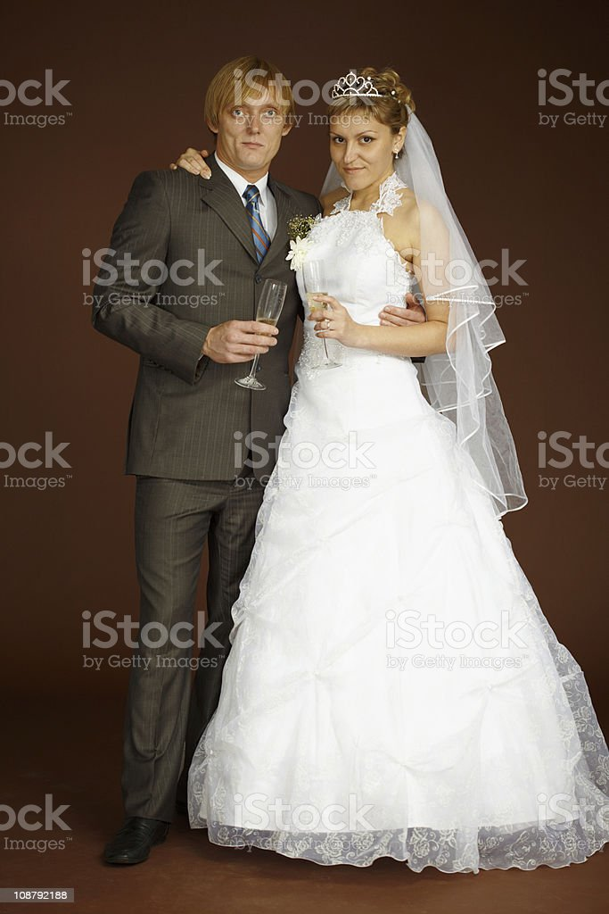 Studio portrait of groom and bride royalty-free stock photo