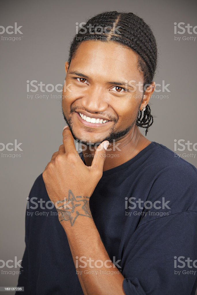 Studio portrait of handsome affrican-american man on grey royalty-free stock photo