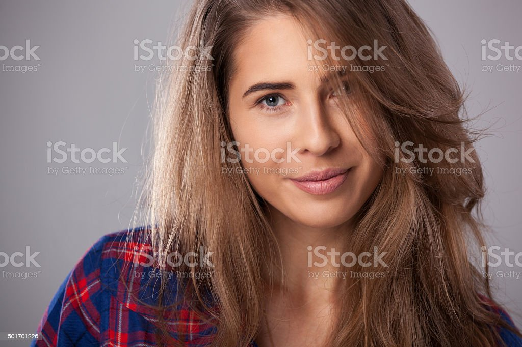 Studio portrait of happy young woman. stock photo