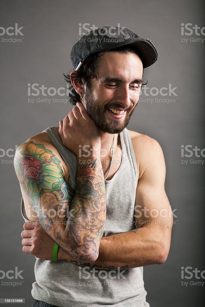 Studio Portrait of Laughing Tattooed Man royalty-free stock photo