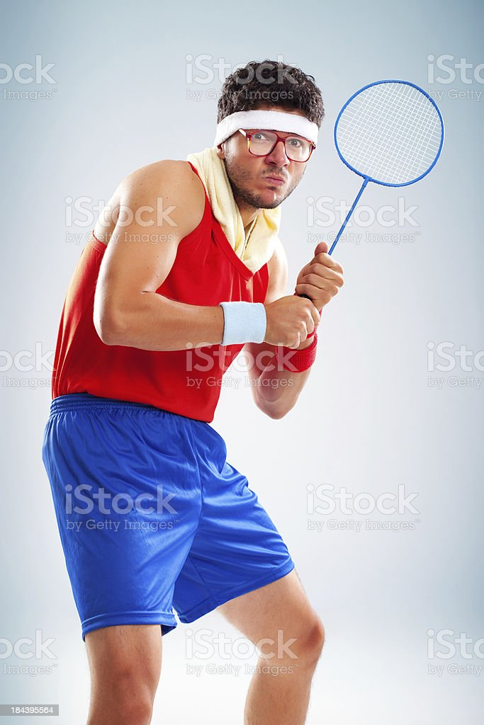 Studio portrait of scared tennis player holding racket stock photo