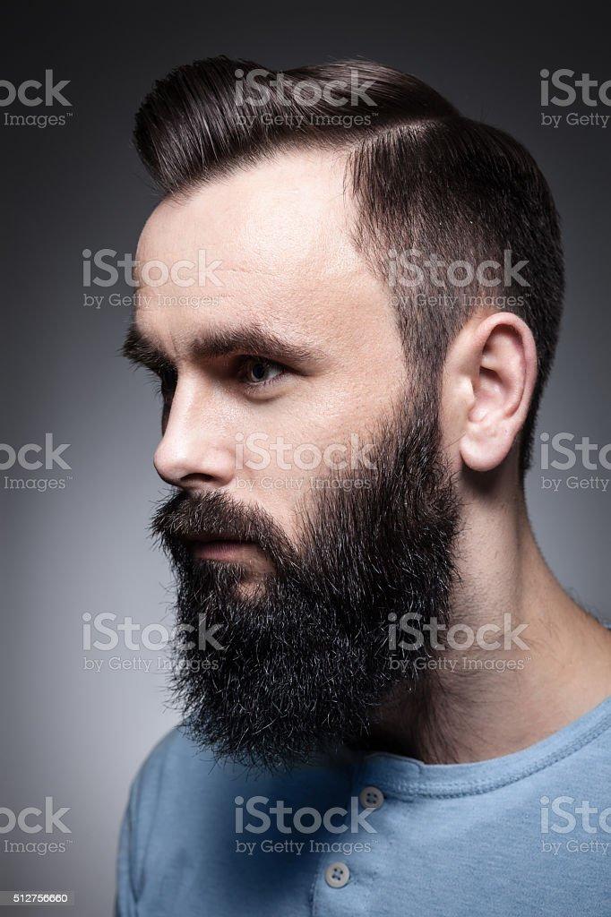 studio portrait of stylish bearded man; stock photo