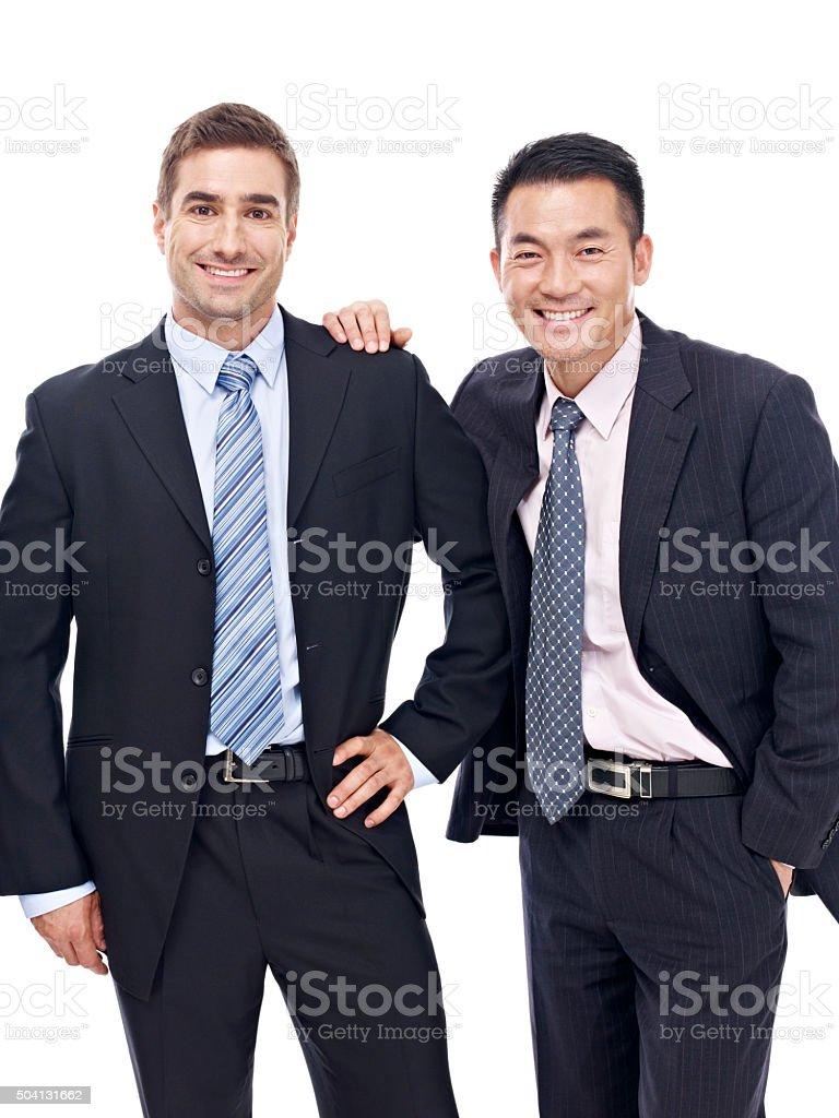 studio portrait of two businessmen stock photo