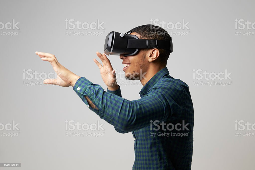 Studio Portrait Of Video Game Designer Wearing VR Headset stock photo