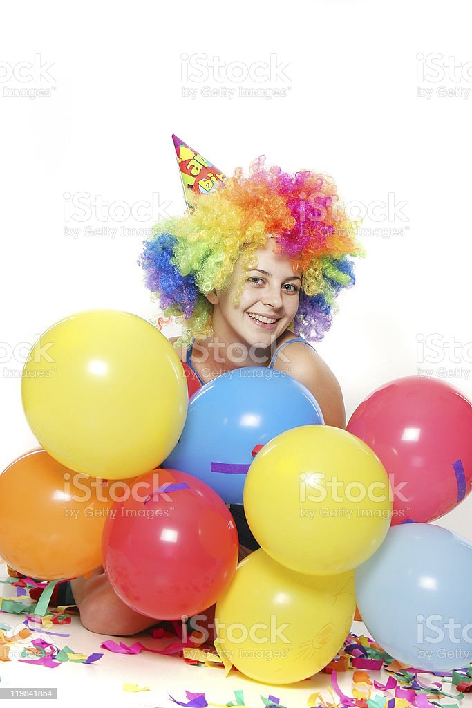 studio portrait of young happy woman with balloons stock photo