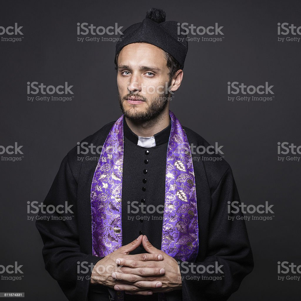Studio portrait: serious pastor stock photo