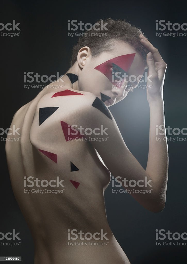Studio portrait with painted triangles royalty-free stock photo