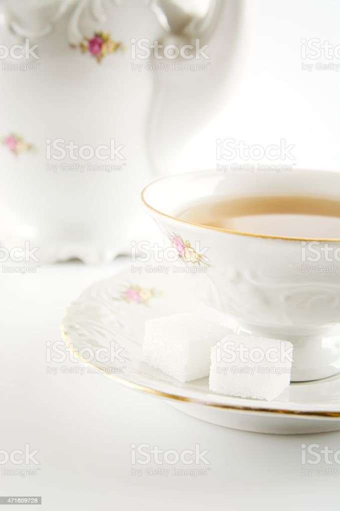 Studio shot  in old-style jug with tea on white backgro stock photo