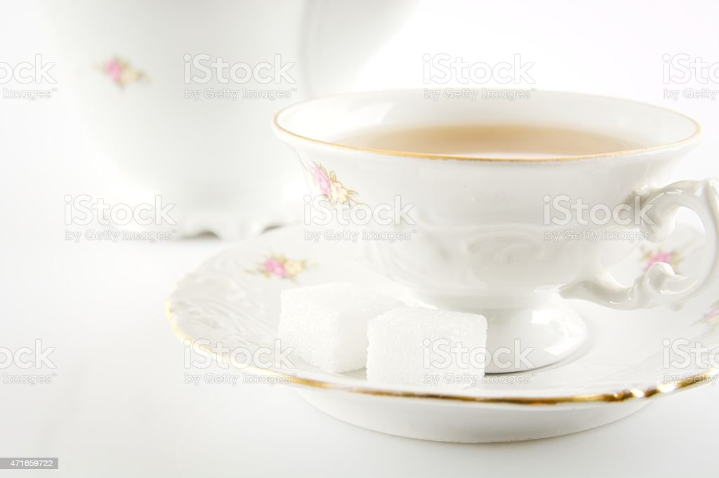 Studio shot in old-style jug with tea on white stock photo