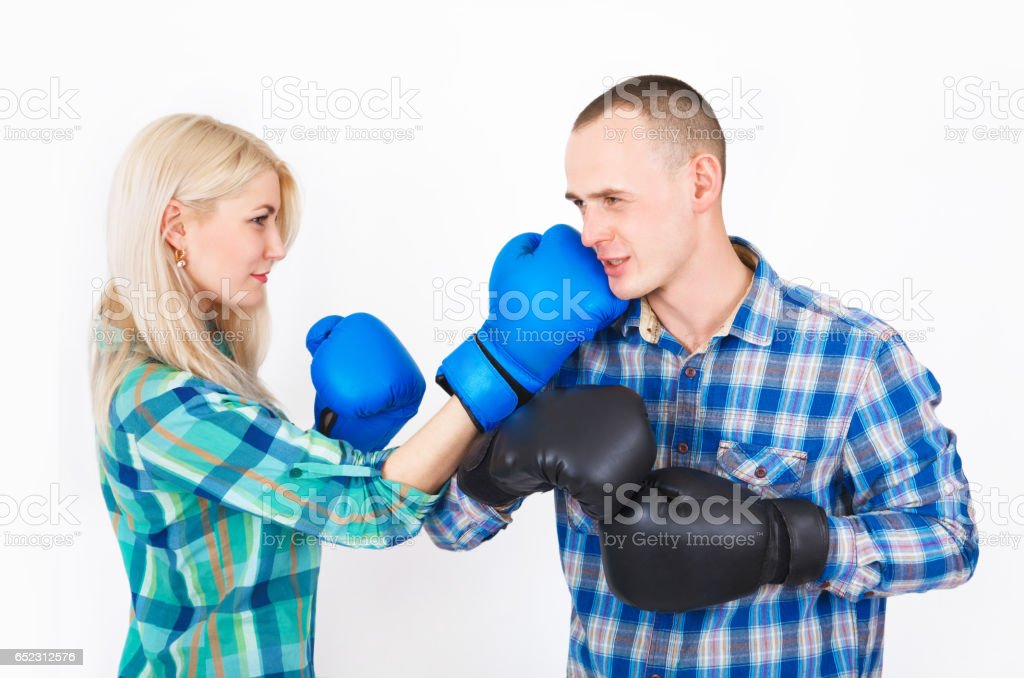Studio shot of a beautiful funny couple expressive fighting. stock photo