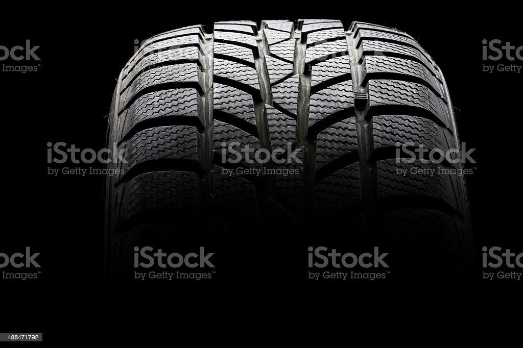 Studio shot of a black car tire stock photo