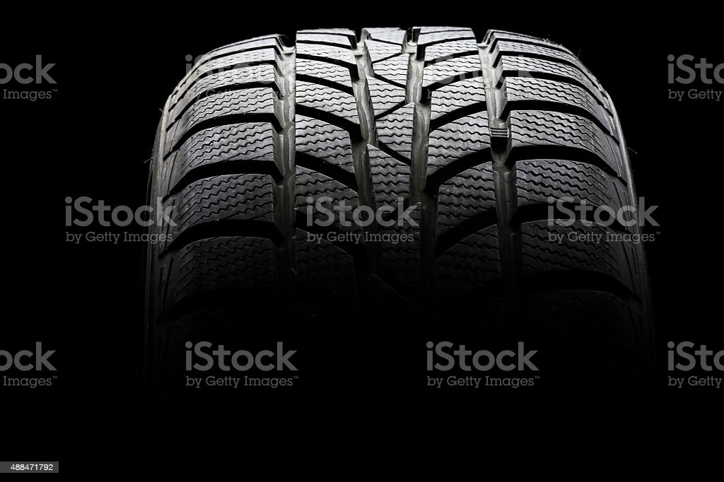 Studio shot of a black car tire stock photo