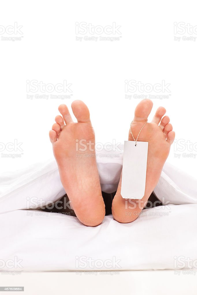 Studio shot of a dead body with a toe tag stock photo