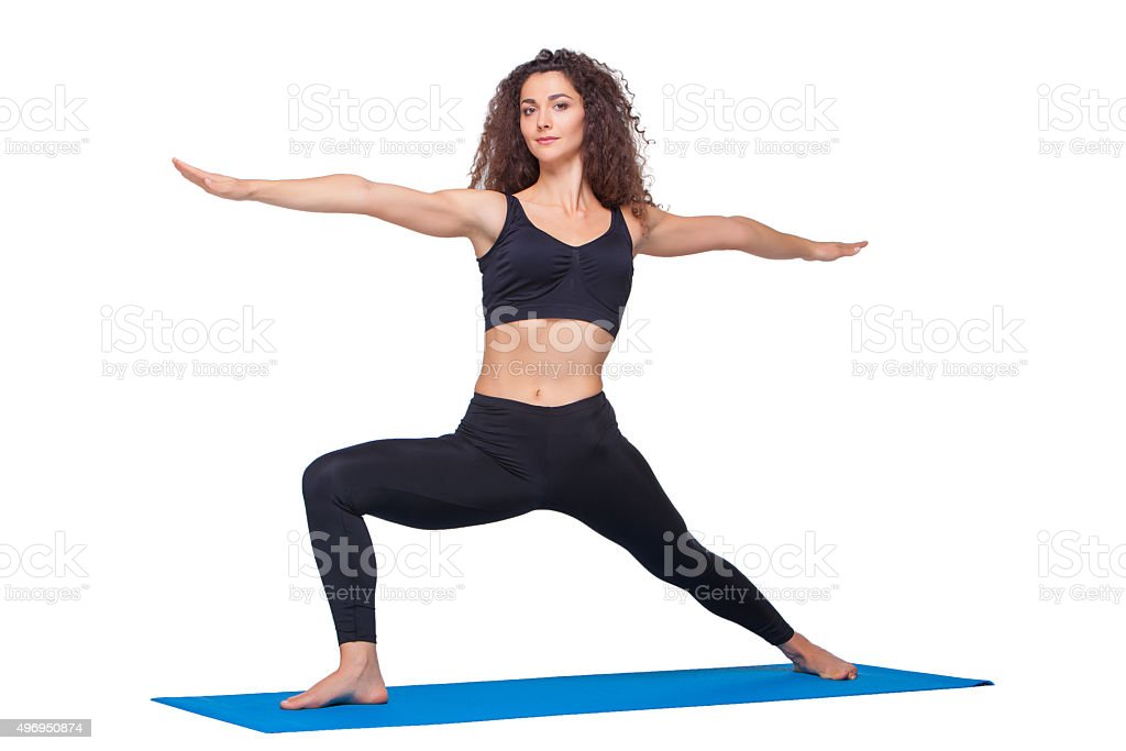 Studio shot of a young fit woman doing yoga exercises stock photo