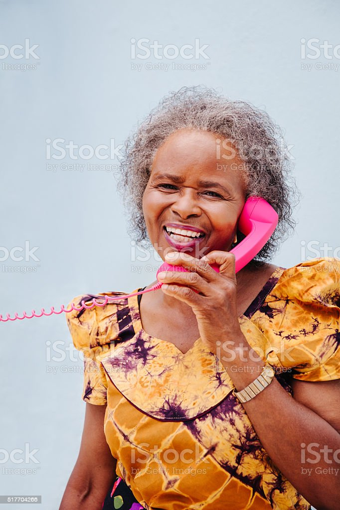 Studio shot of African woman on her telephone stock photo