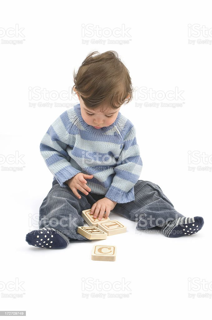 Studio shot of baby playing with blocks royalty-free stock photo