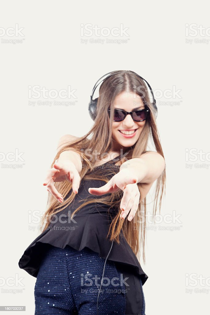 Studio shot of beautiful woman with sunglasses and headset royalty-free stock photo