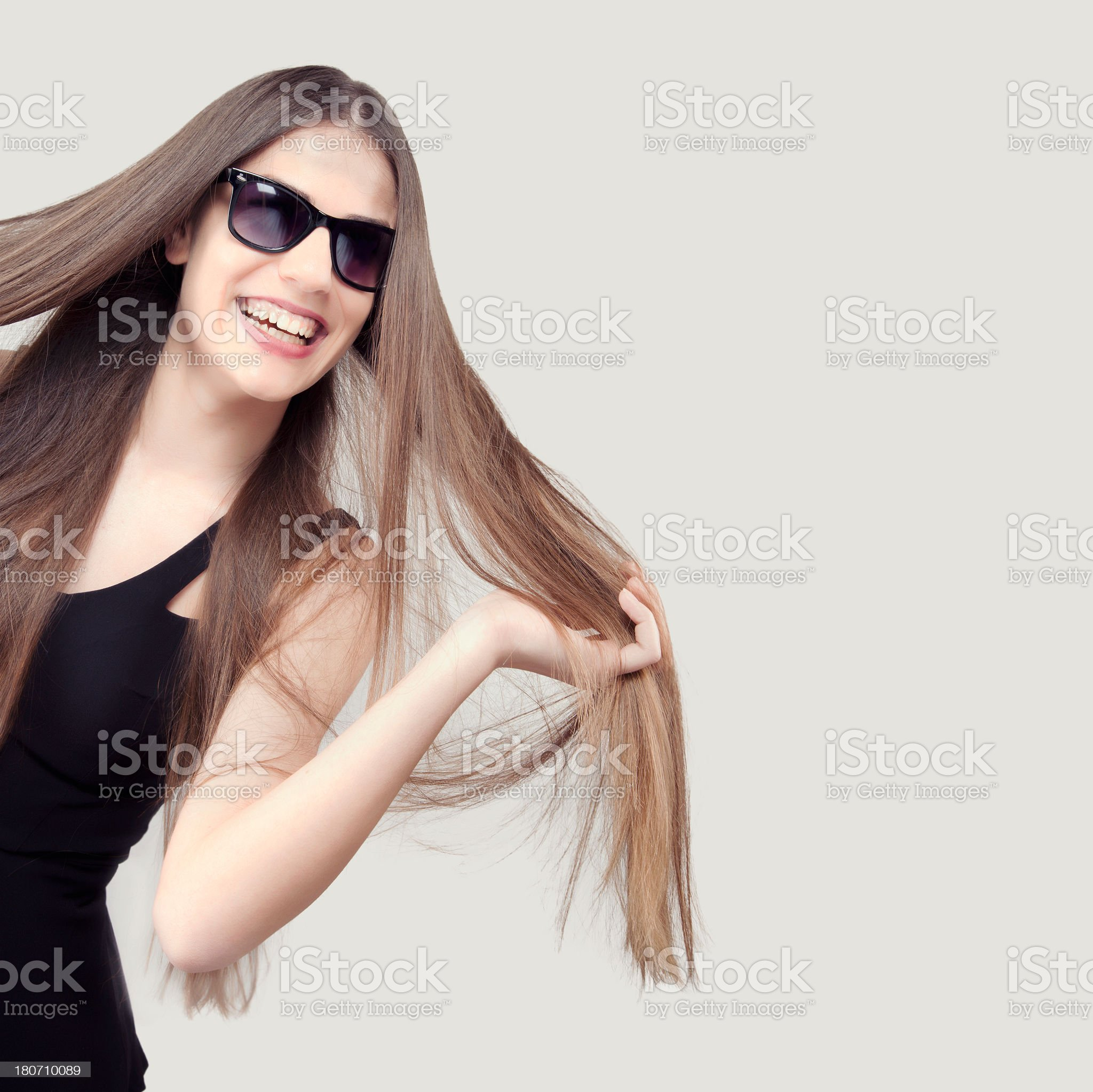 Studio shot of beautiful woman with sunglasses royalty-free stock photo