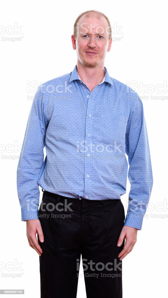 Studio shot of businessman standing against white background stock photo
