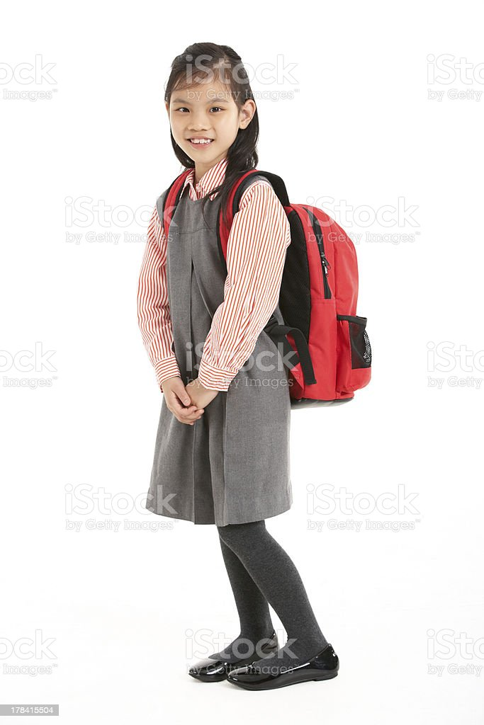 Studio Shot Of Chinese Girl In School Uniform stock photo