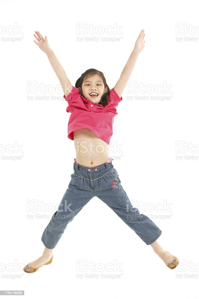 Studio Shot Of Chinese Girl Jumping In Air stock photo