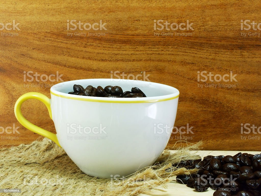 studio shot of coffee beans on wooden background still life stock photo